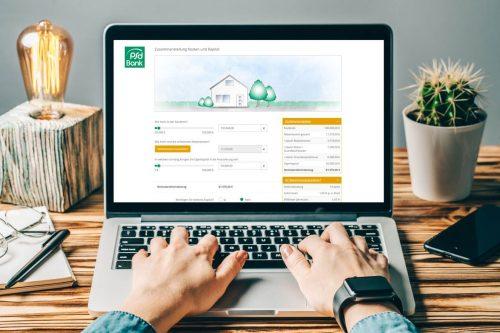 Screenshot PSD Bank Antrag Baufinanzierung Laptop am Schreibtisch
