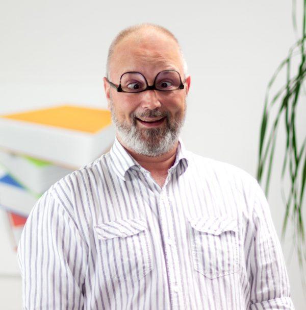 Portrait Volker Grimasse bei ECON Application