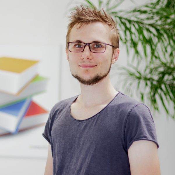 Portrait Kevin Grimasse bei ECON Application
